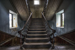 Wooden staircase in an abandoned house royalty free stock images