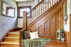 Wooden staircase with bench in old house Royalty Free Stock Image