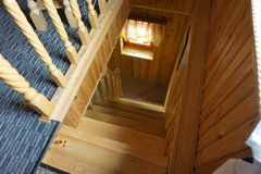 Wooden staircase in a country house. royalty free stock image