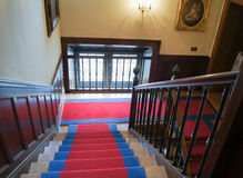 Wooden staircase. Covered with carpet inside the building Royalty Free Stock Photos