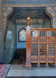 Wooden staircase, decorated wooden balustrade, Turkish ceramic tiles wall, ornate ceiling, stained glass windows. Cairo, Egypt - December 2, 2017: Wooden Royalty Free Stock Image