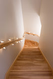 Wooden staircase decorated with lights Royalty Free Stock Image