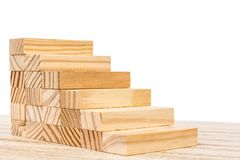 Wooden staircase in front of white background as a symbol of rocky ascent stock photos
