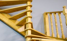 Modern wooden staircase in the house. The view from the top. royalty free stock photography