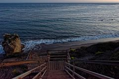 Staircase to beach, El Matador State Beach, Malibu, California. Wooden staircase leading to sandy beach at El Matador State Beach, Malibu, California Royalty Free Stock Photo