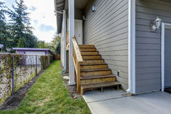Wooden staircase leading to white front porch. Gray house exterior. Northwest, USA Royalty Free Stock Photos