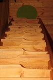 Wooden staircase. With ledges and antislip strips Royalty Free Stock Photo