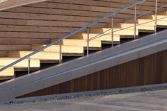 Wooden staircase with metal railing, horizontal photo Royalty Free Stock Photography