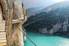A wooden staircase at rock cliff as part of hiking path in Mont Rebei canyon, Spain. The Congost de Montrebei is a bridle path carved out of the cliff face of royalty free stock image