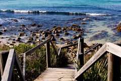 Wooden staircase to rocky surf beach - Boomerang Beach, New Sout Stock Photography
