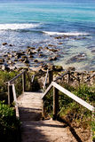 Wooden staircase to rocky surf beach - Boomerang Beach, New Sout Stock Photos