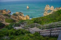 Wooden staircase to sandy Praia do Camilo beach near Lagos, Portugal. Royalty Free Stock Photos