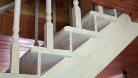 Wooden staircase to the second floor. White wooden stairs in the cottage royalty free stock photography