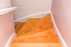 Wooden staircase winding down Stock Photos