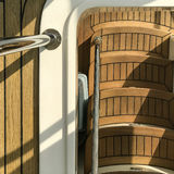 Wooden staircase in the yacht with sunlight and shadow Stock Image