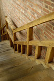 Wooden stairs. Wooden staircase and brick wall Royalty Free Stock Images