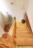 Wooden stairs. In house, interior decoration, wood and white walls Royalty Free Stock Images