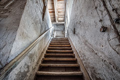 Wooden stairs in an abandoned house. Old stairs inside a forgotten home Stock Photography