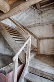 Wooden stairs in an abandoned house. Old stairs inside a forgotten home Stock Photo