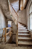 Wooden stairs in an abandoned house. Old stairs inside a forgotten home Royalty Free Stock Photo