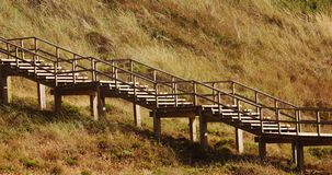 Wooden stairs. Along a hill of a portuguese beach - paredes da victoria Stock Photo
