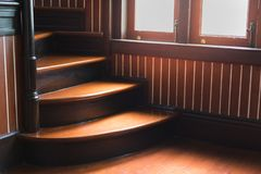 Wooden stairs in an ancient house. With warm light from windows royalty free stock photography