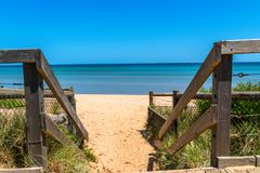 Wooden stairs at the beach. Wooden stairs leading to the beach at Frankston, Victoria, Australia Royalty Free Stock Image
