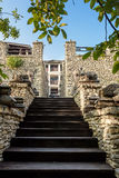 Wooden stairs in a castle with stone walls at orheiul vechi vila etnica Royalty Free Stock Photo