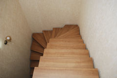 Wooden stairs. The construction of the stairs in the house. Stock Photos