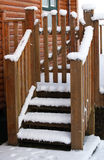 Wooden stairs covered with snow Stock Image