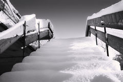 Wooden stairs covered in winter snow Stock Photography
