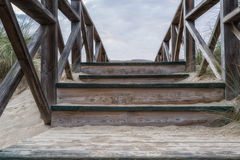 Wooden stairs in the dunes. On the beach Stock Photo