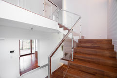 Wooden stairs with elegant balustrade Stock Photos