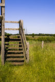 Wooden Stairs. In field - bright day Royalty Free Stock Photography