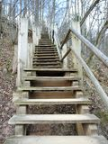 Wooden stairs going on hill top, Latvia. Beautiful wooden stairs going on hill top in spring royalty free stock photo
