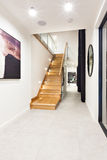 Wooden stairs through the hallway in a luxury house Royalty Free Stock Photo