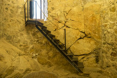 Wooden stairs, Interior of the medieval castle of the city of Co Stock Photo