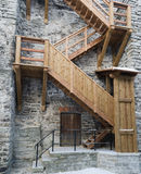 Wooden stairs the leader on a medieval city wall Stock Image