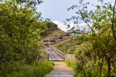 Wooden stairs leading to North Sea beach near Ostend, Belgium Royalty Free Stock Photo
