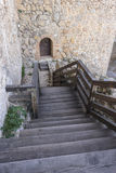 Wooden stairs in a medieval castle. Town of Consuegra in the pro Stock Photo