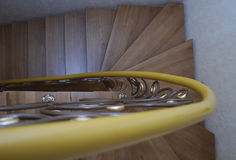 Wooden stairs and metal tracery forged railing. Stock Image