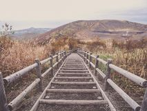 Wooden stairs on Mt. Usu or Ususan at Hokkaido, Japan. With retro photo filter.