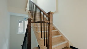 Wooden stairs in a new house stock video