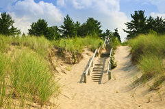 Wooden stairs over dunes at beach Stock Photo