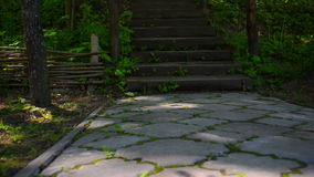 Wooden stairs in the park stock video footage