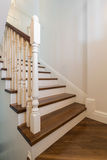 Wooden stairs with railing Royalty Free Stock Photography