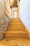 Wooden stairs in rustic home Stock Photo