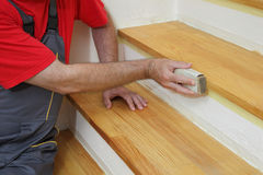 Wooden stairs sanding, home renovation Royalty Free Stock Photography