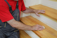 Wooden stairs sanding Stock Image