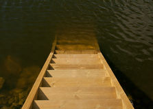 Wooden stairs into the sea Royalty Free Stock Images